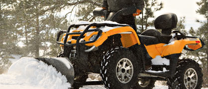 An ATV plowing snow
